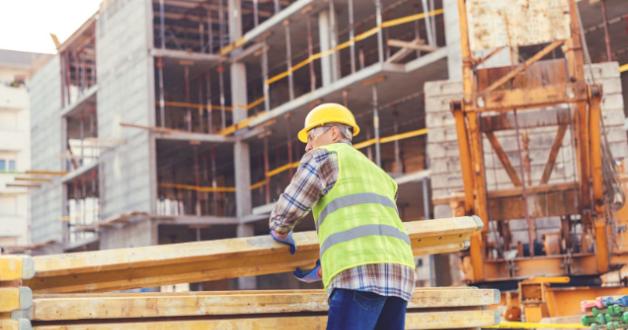 Arbeiter zu Hause Baustellenarbeit
