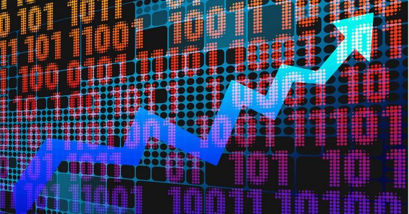 Pfeil nach oben und im Hintergrund Finanztabelle