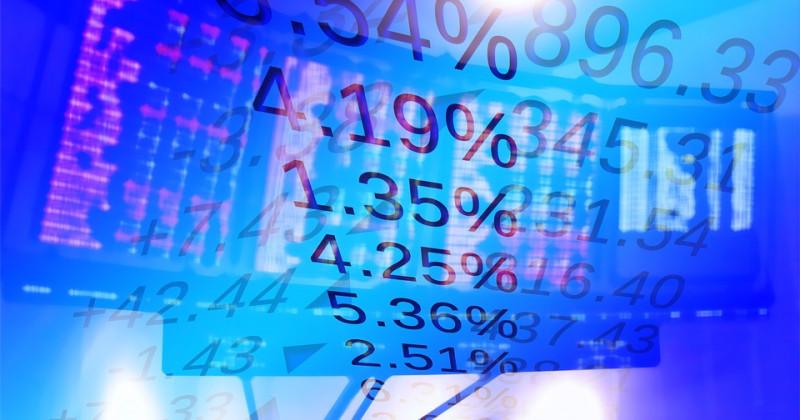 Prozentsatz und Börsentafel im Hintergrund